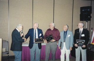 President Jack Rencher with Harry Gobrecht, Gary Moncur, Eddie Deerfield and Ed Miller - Awardees of the 303rd BG Presidental Heritage Award for 2002